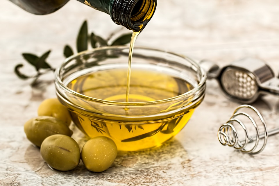 pouring olive oil opting for monsoon